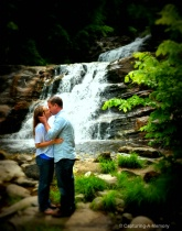 Couple Kissing at Waterfall
